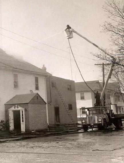 Ed Doiron in P.W. bucket truck, pressed into service on School Street (Photo by Stuart Langer)